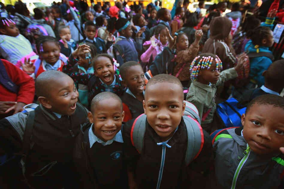 Students at Frazier International Magnet School wait outside before the start of school on