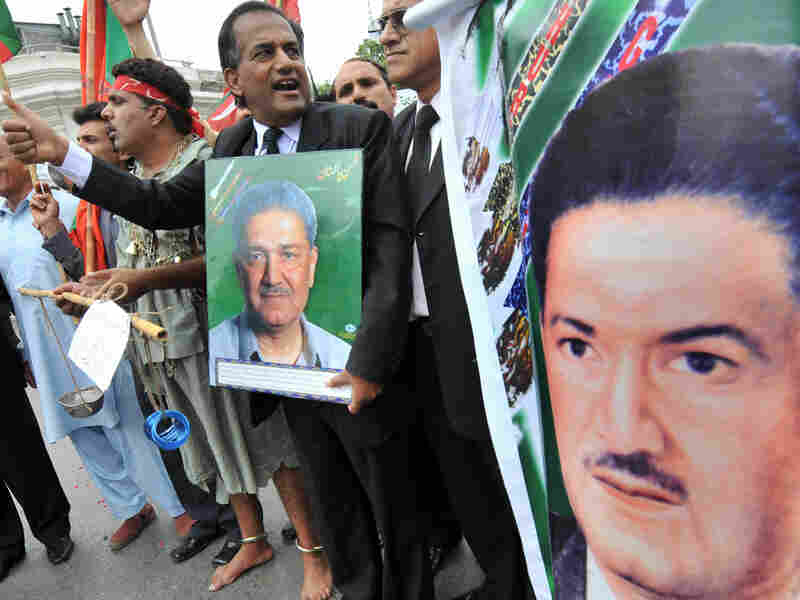 Pakistani lawyers carry posters of Khan at a rally in support of him in Lahore in 2008.