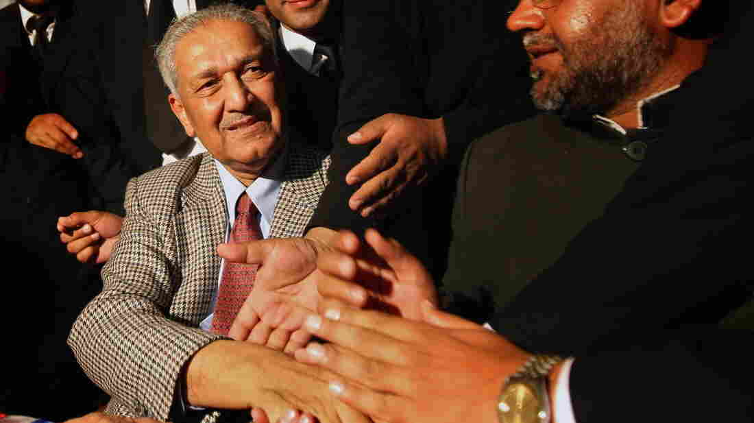 Abdul Qadeer Khan, regarded as the father of Pakistan's nuclear bomb, shakes hands with supporters at the Rawalpindi High Court in 2010. The controversial Khan, who sold nuclear secrets to Iran and North Korea, is now entering politics.