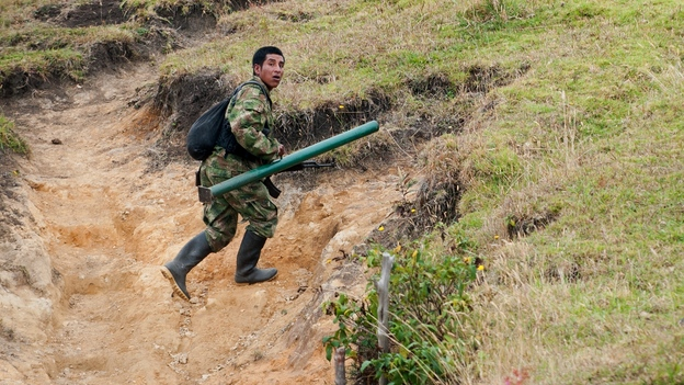 A member of the Revolutionary Armed Forces of Colombia, or FARC, runs to take position during a firefight with the Colombian army in the mountains of Cauca state on July 12. For now, fighting continues even as the two sides prepare for peace talks. (AFP/Getty Images)