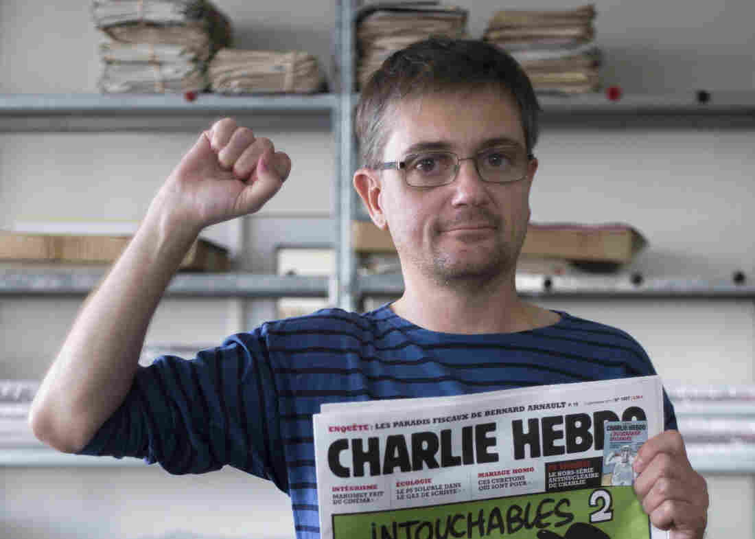 "At the offices of the French satirical weekly Charlie Hebdo earlier today, publisher/editor Stephane Charbonnier (""Charb"") struck a defiant pose."