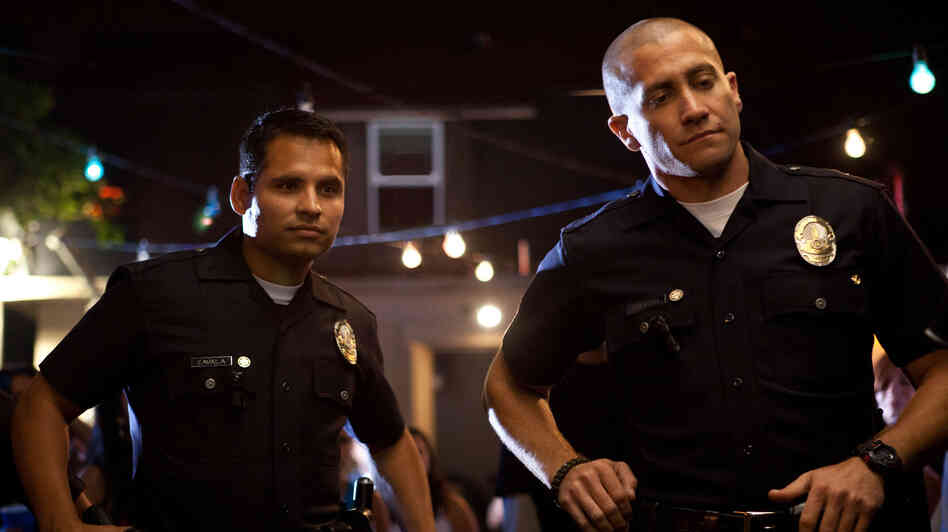 Officers Mike Zavala (Michael Peña) and Brian Taylor (Jake Gyllenhaal) tangle with a vicious drug cartel in End of Watch.
