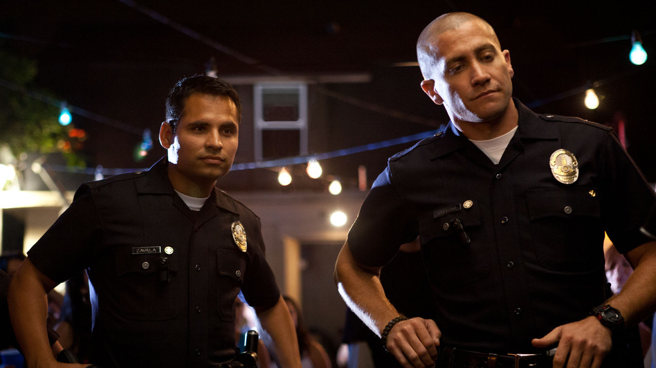 Officers Mike Zavala (Michael Peña) and Brian Taylor (Jake Gyllenhaal) tangle with a vicious drug cartel in <em>End of Watch</em>.