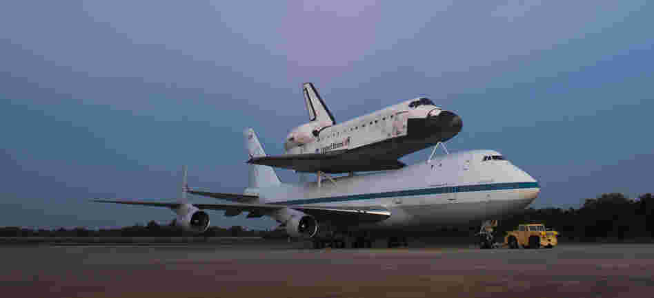 Space shuttle Endeavour, attached to a 747, on the tarmac at the Kennedy Space Center in Florida.