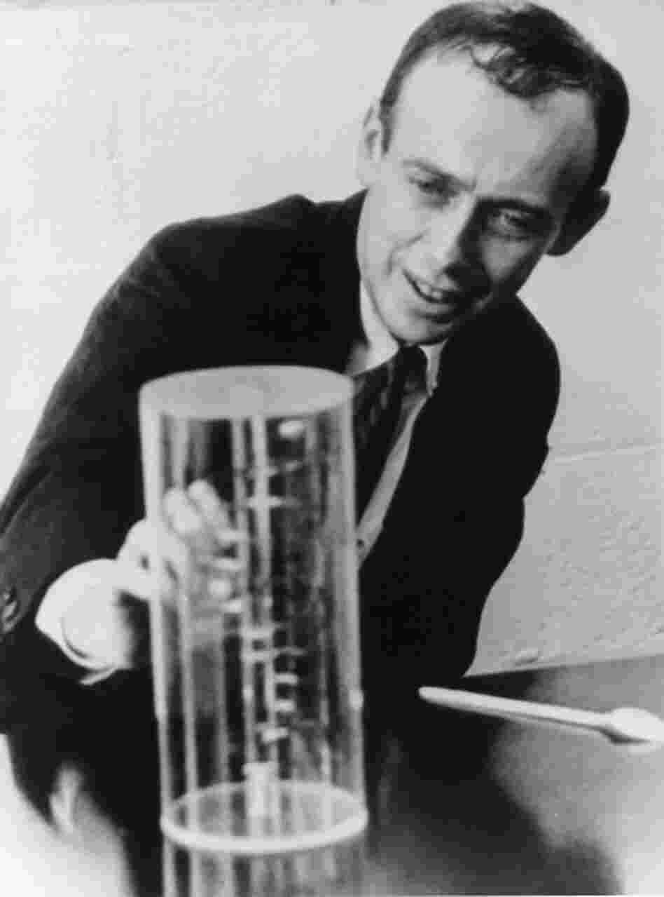 Dr. James Watson looks at a reproduction of the structure of DNA, which he helped discover, in this 1962 photograph. Decades later, Watson was one of the first people to have his entire genome sequenced.