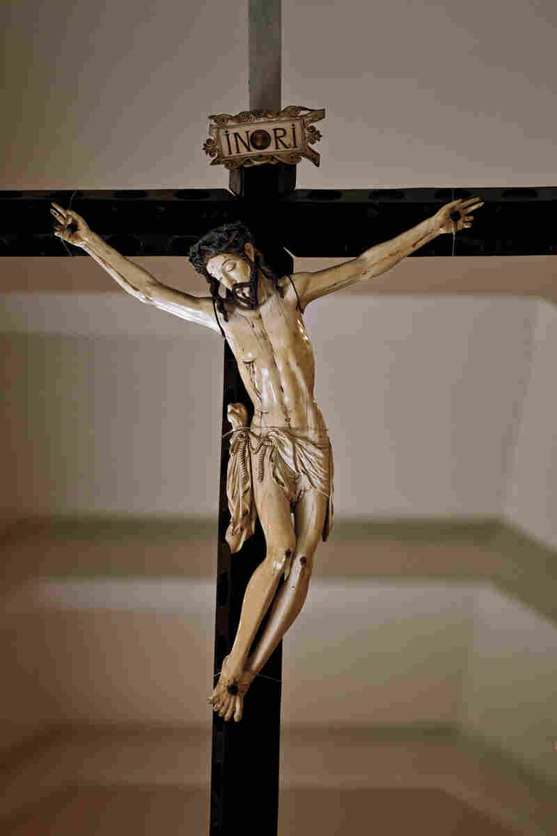 """The largest ivory crucifix in the Philippines hangs in a museum in Manila. The body of Christ, 30 inches long, is carved from a single tusk. The piece dates to the early 1600s, when Spanish galleons began bringing Asian ivory craftsmanship to Spain and the New World."""
