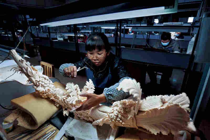 """""""A worker in China's largest ivory-carving factory finishes a piece symbolizing prosperity. China legally bought 73 tons of ivory from Africa in 2008; since then, poaching and smuggling have both soared."""""""