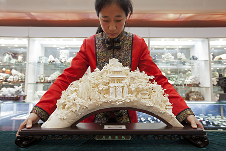 """""""A sculpture like this can take a master carver years to produce. Front and center are the popular Taoist gods Shou, Lu and Fu --€"""" symbols of long life, money and luck. 'We hope --€"""" no, we insist --€"""" we can continue to protect these skills,' says Wang Shan, secretary-general of the China Arts and Crafts Association."""""""