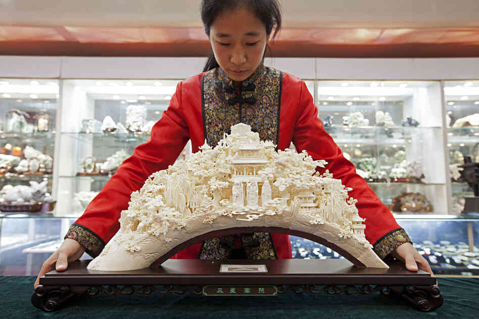 """""""A sculpture like this can take a master carver years to produce. Front and center are the popular Taoist gods Shou, Lu and Fu --€"""" symbols of long life, money and luck. 'We hope --€"""" no, we insist --€"""" we can continue to protect these skills,' says Wang Shan, secretary-general of"""
