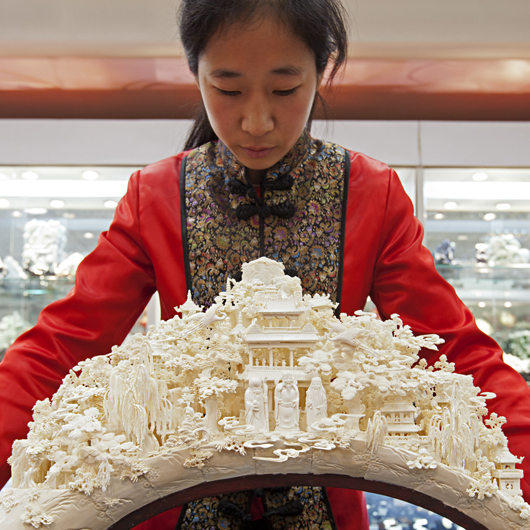 """A sculpture like this can take a master carver years to produce. Front and center are the popular Taoist gods Shou, Lu and Fu -- symbols of long life, money, and luck. 'We hope -- no, we insist -- we can continue to protect these skills,' says Wang Shan, secretary-general of the China Arts and Crafts Association."""