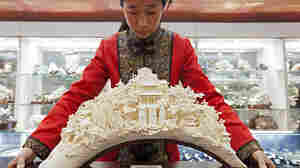 """""""A sculpture like this can take a master carver years to produce. Front and center are the popular Taoist gods Shou, Lu and Fu — symbols of long life, money, and luck. 'We hope — no, we insist — we can continue to protect these skills,' says Wang Shan, secretary-general of the China Arts and Crafts Association."""""""