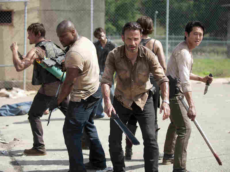 A group of humans struggles to survive a zombie apocalypse in AMC's The Walking Dead.