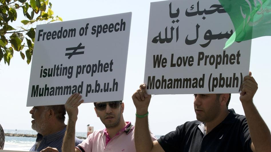 Arab-Israeli men protest a video mocking the Prophet Muhammad, in front of the U.S. Embassy in Tel Aviv, Israel, on Thursday.