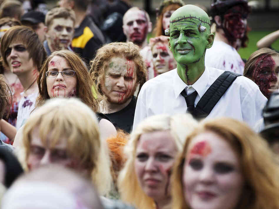 "Need to lighten up your day? Invite some of these folks. (A ""zombie walk"" in Stockholm on Aug. 25"