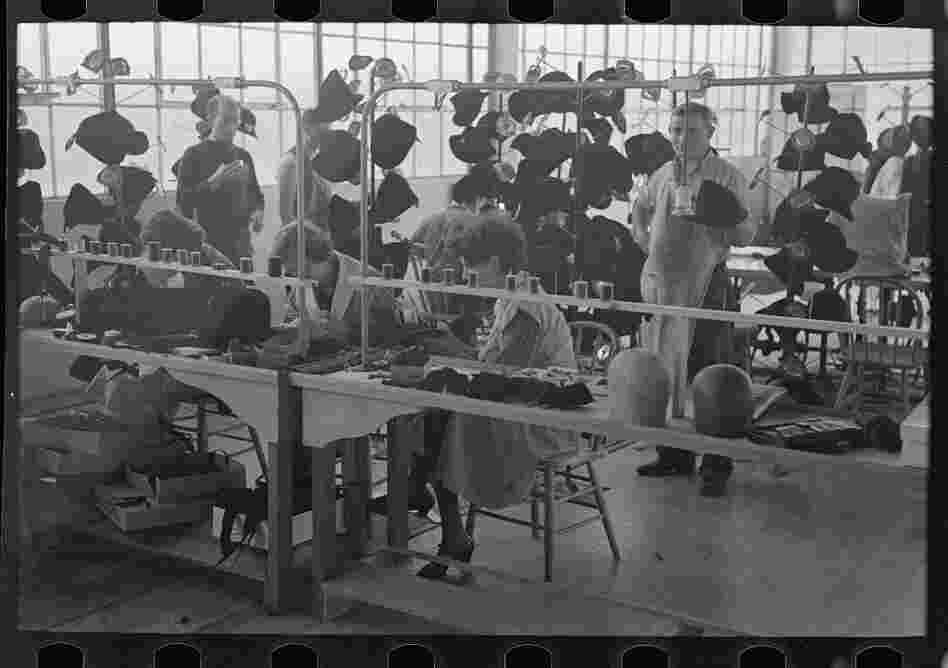 Women at work in the millinery department of the cooperative garment factory.
