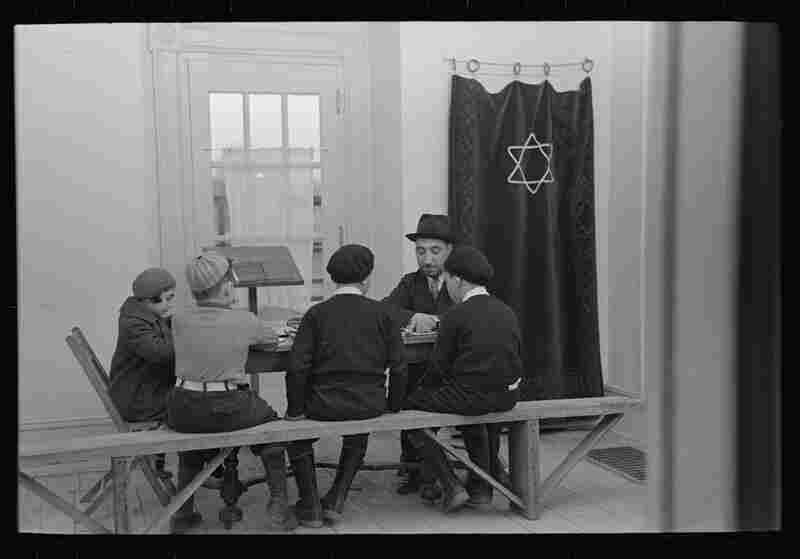 A visiting rabbi teaches children.  The majority of Jersey Homesteads came from the Bronx's Jewish community.