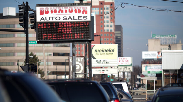 A used-car lot displays a sign in support of Republican presidential candidate Mitt Romney in Manchester, N.H., in January.