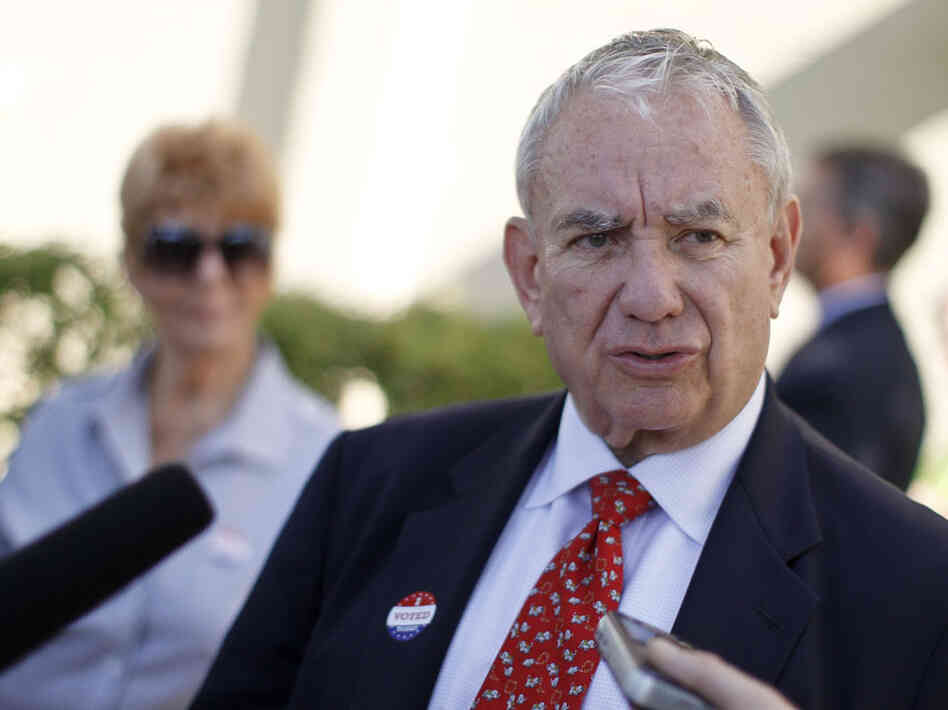 Wisconsin Senate candidate Tommy Thompson, a Republican, talks to the media after voting in the primary election on Aug. 14 in Madison.