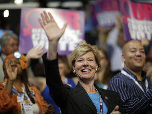 Wisconsin Senate candidate Tammy Baldwin sits with state delegates during the Democratic National Convention in Charlotte, N.C., on Sept. 5.