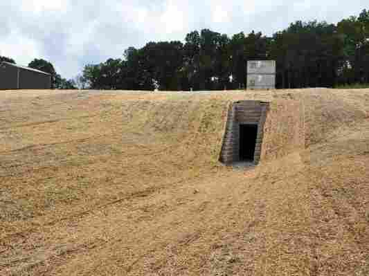 The artificial cave built for bats in Tennessee has a human entrance below and a bat entrance above. In the summer, any fungus left by the bats over the winter will be cleaned up.