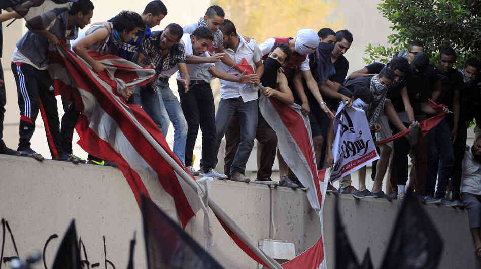 Egyptians destroy an American flag pulled down from the U.S. Embassy in Cairo, Sept. 11, during a protest over the film that insulted the Prophet Muhammad.