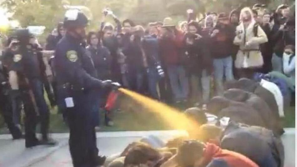 Nov. 18, 2011: Occupy protesters get sprayed at University of California Davis. (YouTube)