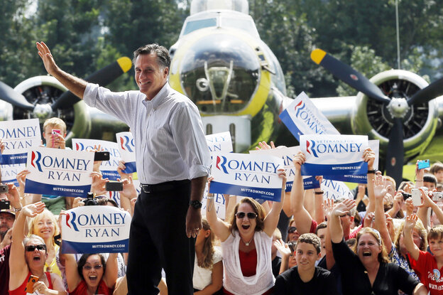 Mitt Romney takes the stage at a campaign rally at the Military Aviation Museum in Virginia Beach, Va., on Sept. 8.