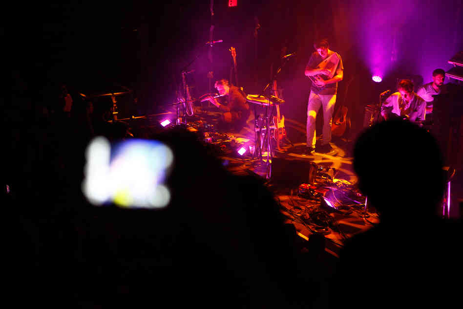 For much of the 9:30 Club performance, the band was bathed in warm red light, with jellyfish-like lanterns that slowly rose and fell throughout the show.