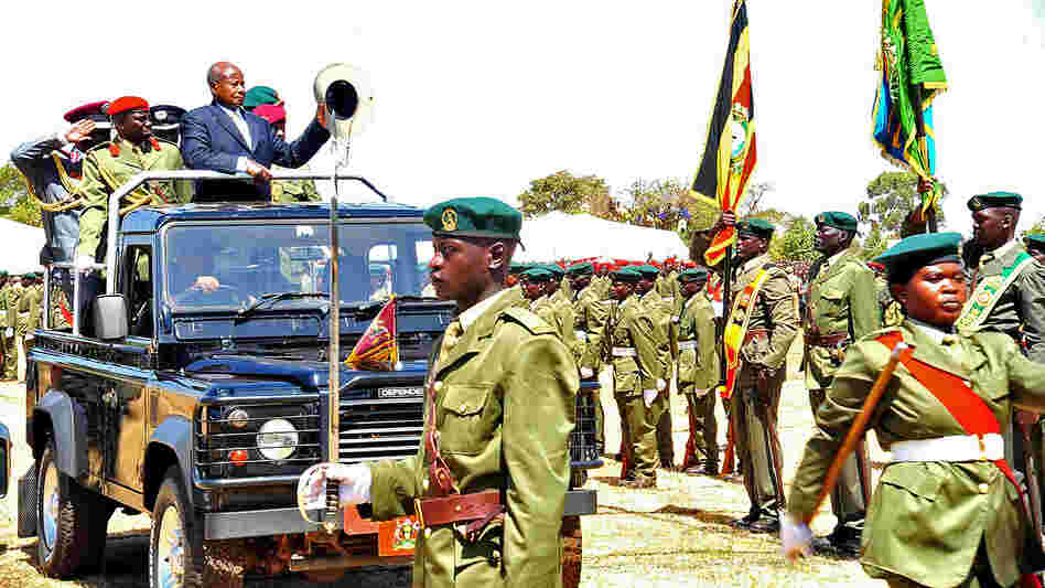 President Yoweri Museveni inspects Ugandan troops at a ceremony honoring Rwandan President Paul Kagame in January of this year.