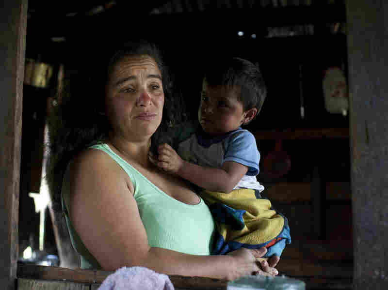 Nohemi Caicedo holds her grandson, Christian Camilo, in the kitchen of her home in Marquetalia, the birthplace of the FARC, in Colombia's Tolima state. Her 18-year-old son was killed in the insurgency after he was forcibly recruited to the FARC. She wants to give peace a chance, for the sake of her other children.
