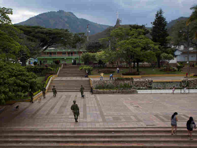 Colombian soldiers patrol the town of Planadas on Sept. 6. The military has stepped up its presence in Tolima state.
