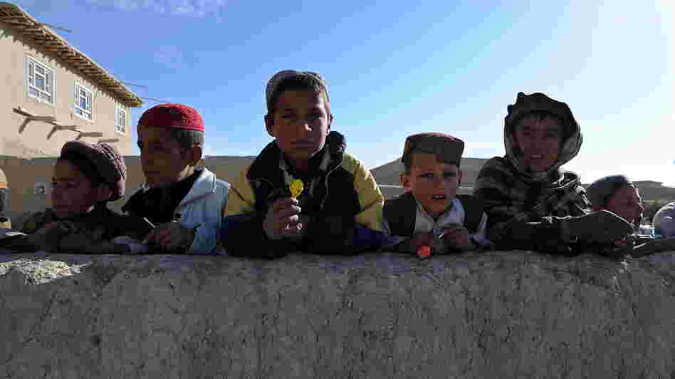January 2011: Boys in the Andar district of Afghanistan gathered to collect candy from passing U.S. Army soldiers. Now, there are reports from that area of locals rising up against the Taliban.