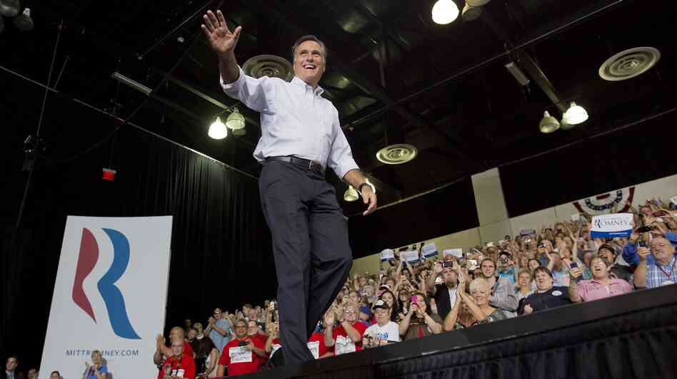 Mitt Romney waves to supporters as he arrives at a rally Friday in Las Vegas.