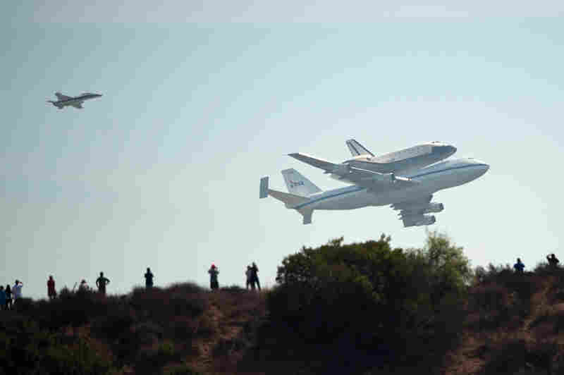 The space shuttle Endeavor flies by Griffith Observatory on its final voyage to the California Science Center in Los Angeles, Calif., Friday.