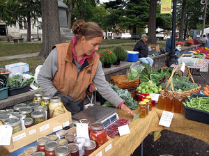 Heidi Accola works a stand at the farmers market in Baraboo, Wis. She runs a 1-acre organic farm with her husband, but she says they don't talk politics at home because it gets too heated.