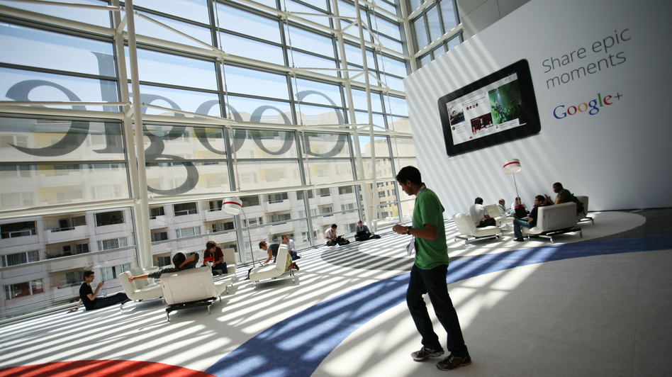 "A Google logo is seen through windows of Moscone Center in San Francisco during Google's annual developer conference, Google I/O, in June. Google is one of several major tech companies known for the ""acqui-hire."""