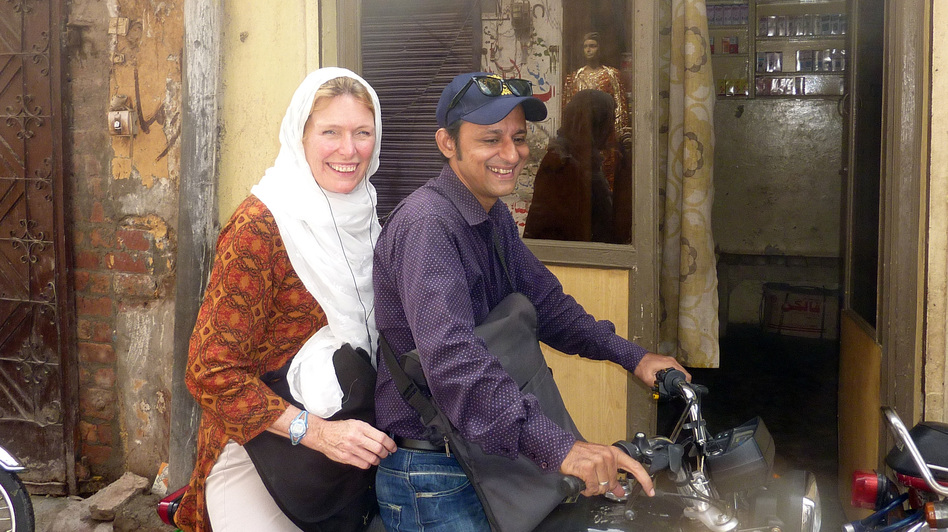 "NPR's Jackie Northam travels through the urban slums of Lahore, Pakistan, with Omer Feroze, a ""social mobilizer,"" who works on polio vaccine campaigns. (NPR)"