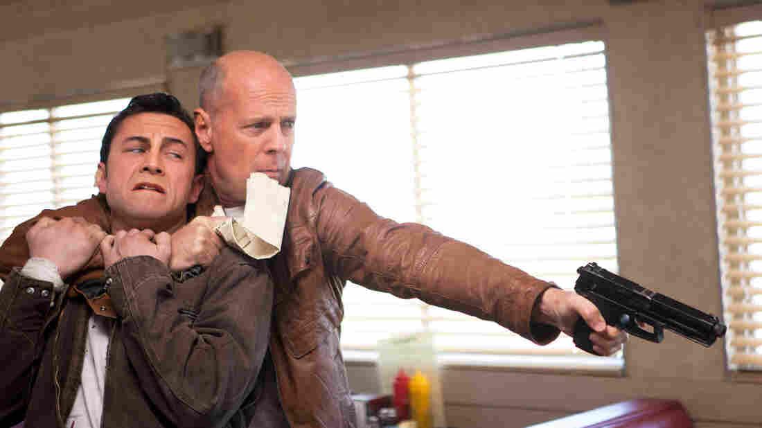 Joseph Gordon-Levitt and Bruce Willis star as present and future versions of the same man in Looper.
