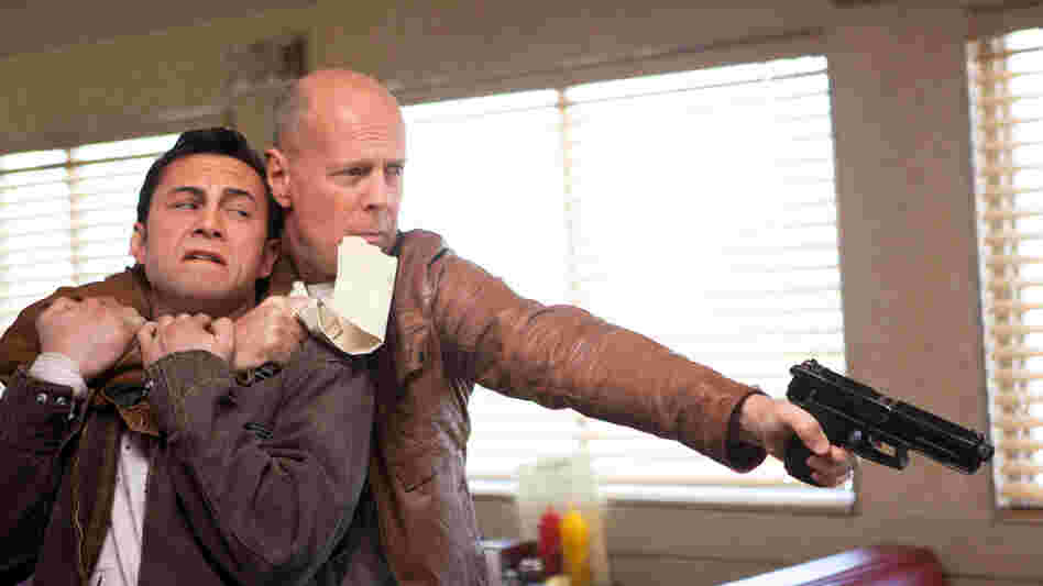 Joseph Gordon-Levitt and Bruce Willis star as present and future versions of the same man in Looper.