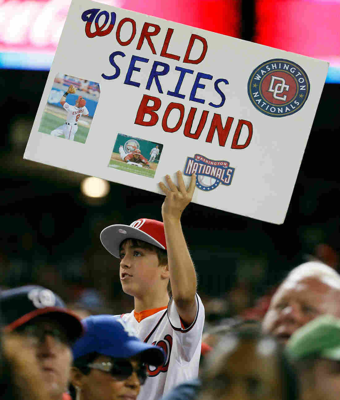 Hoping for the most: A Washington Nationals fan at Thursday night's game in D.C., when the team clinched a playoff spot.