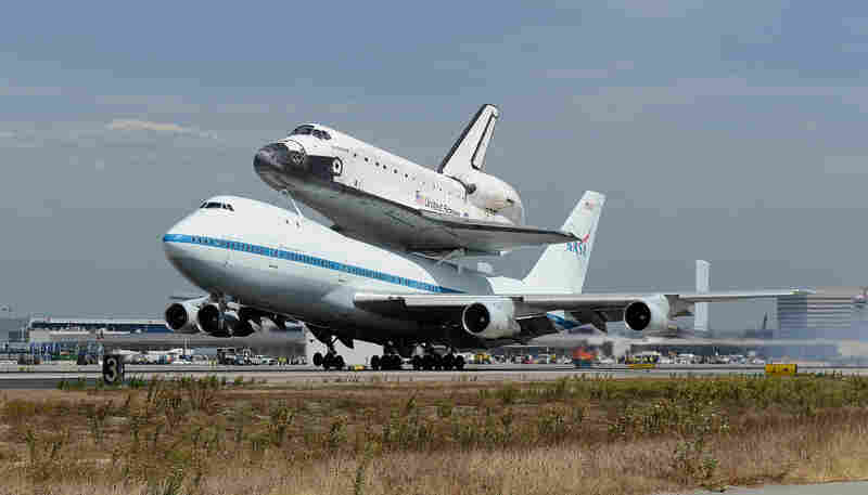Space shuttle Endeavour and its Shuttle Carrier Aircraft land at Los Angeles International Airport.