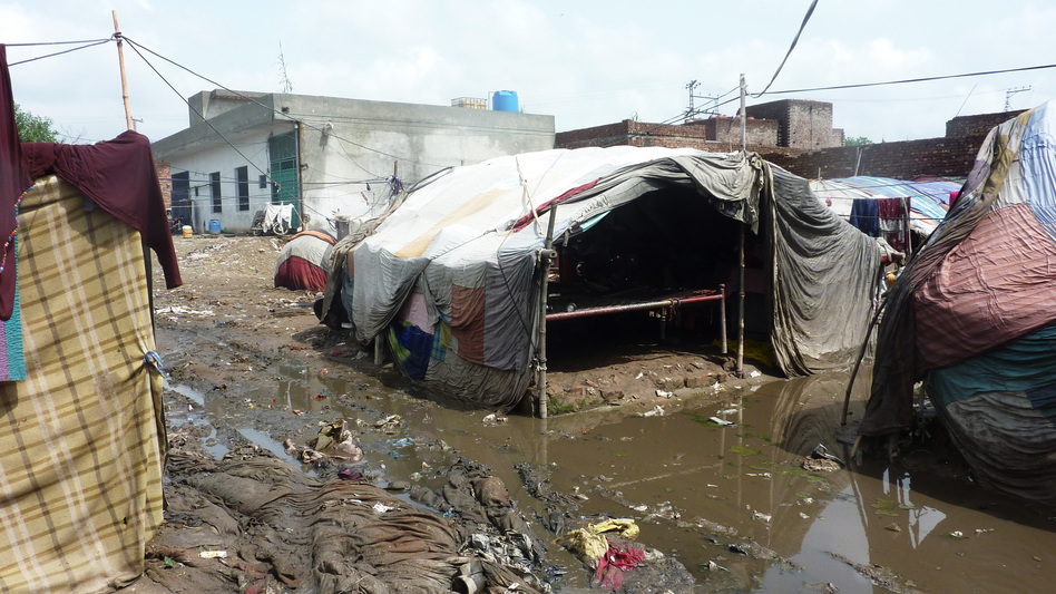 In an urban slum of Pakistan, the population is highly transient. People will raise a cloth tent one day, stay a little while and then move on. (NPR)