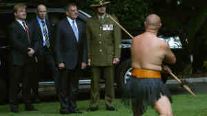 U.S. Secretary of Defense Leon Panetta is given a traditional Maori welcome onto the grounds of the Government House on Friday in Aucklan