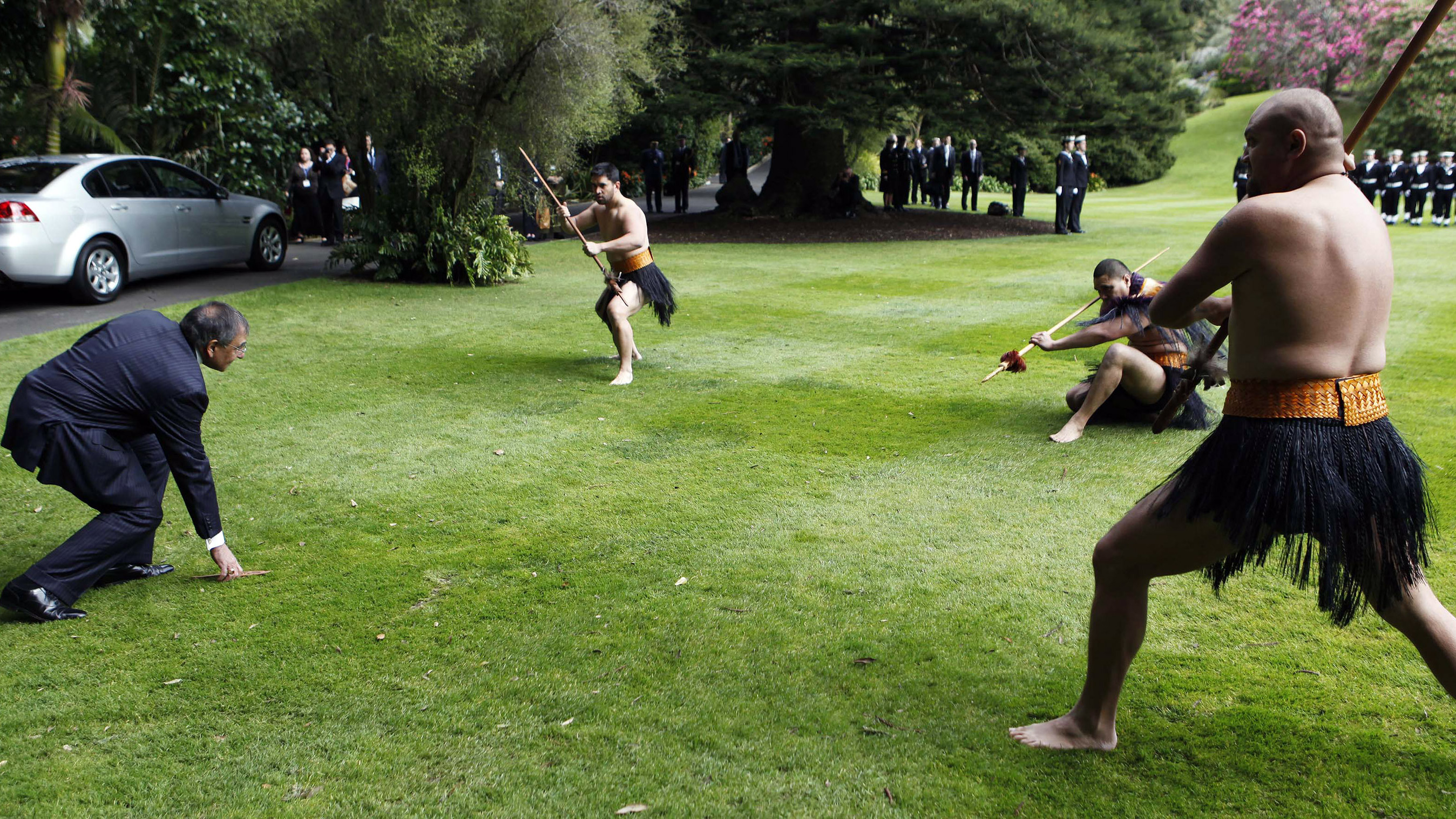 U.S. Defense Secretary Leon Panetta, left, picks up a dart during a Maori welcome ceremony at the Government House in Auckland, New Zealand on Friday.