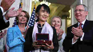Burmese opposition politician Aung San Suu Kyi is presented with a U.S. Congressional Gold Medal at a ceremony at the rotunda of the U.S. Capitol on Wednesday in Washington, D.C.