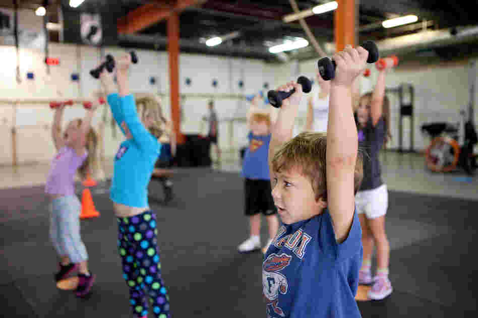 Evan Ciangiulli, 4, completes a warmup that teaches him the right way to lift weights.