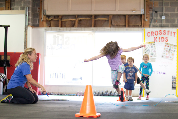 """The CrossFit class for kids in Rockville, Md., includes an exercise called """"jump the snake."""" Tavi Decker, 4, demonstrates."""