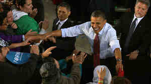 President Obama greets supporters during a campaign rally on Saturday in Milwaukee.