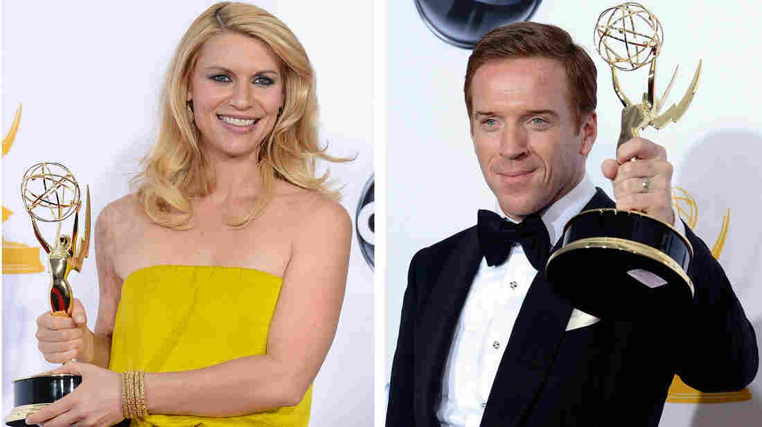 Claire Danes and Damian Lewis hold up their Emmy Awards for Showtime's Homeland.