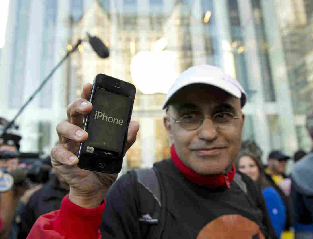 Hazem Sayed exits the Apple store on Fifth Avenue after purchasing his new iPhone 5.